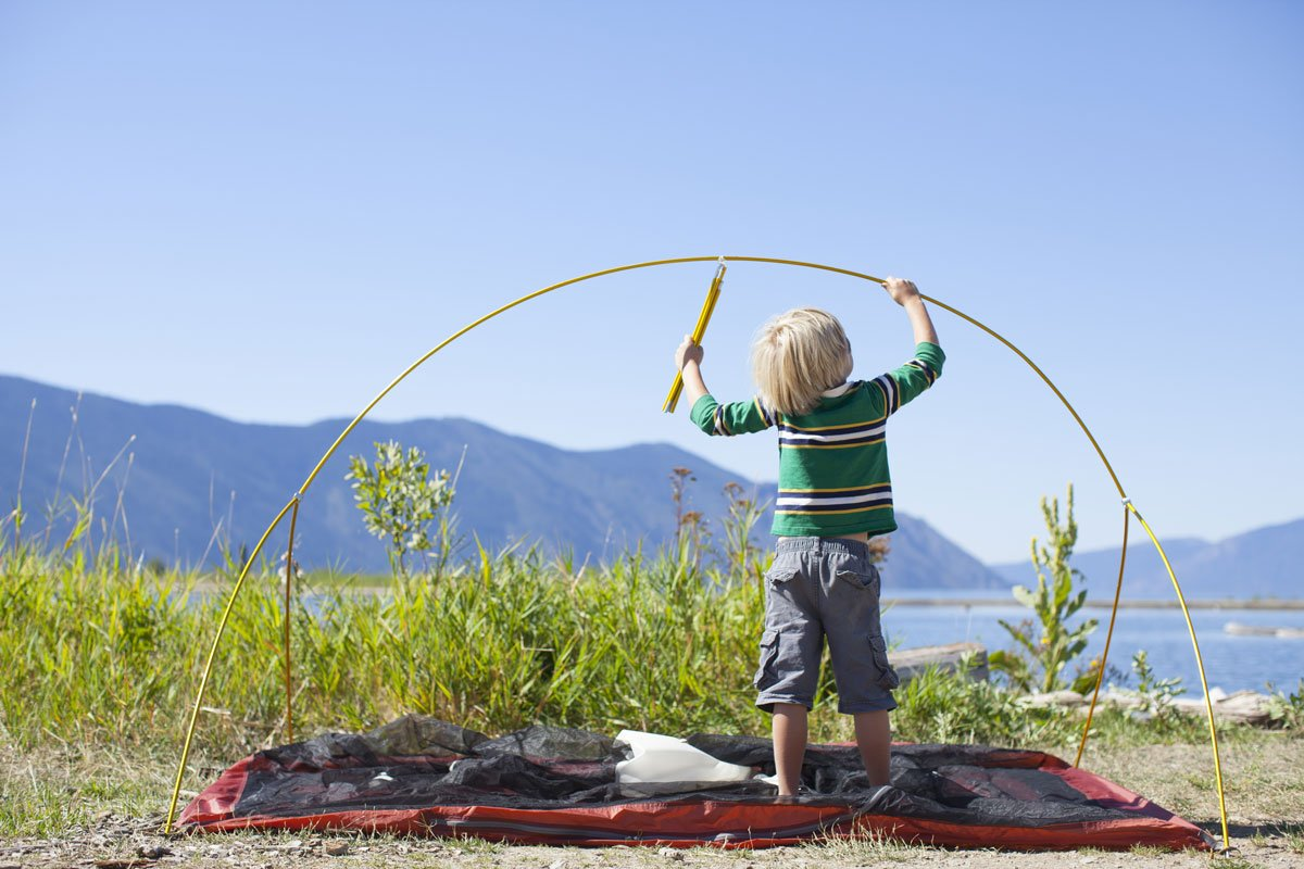 child putting up tent